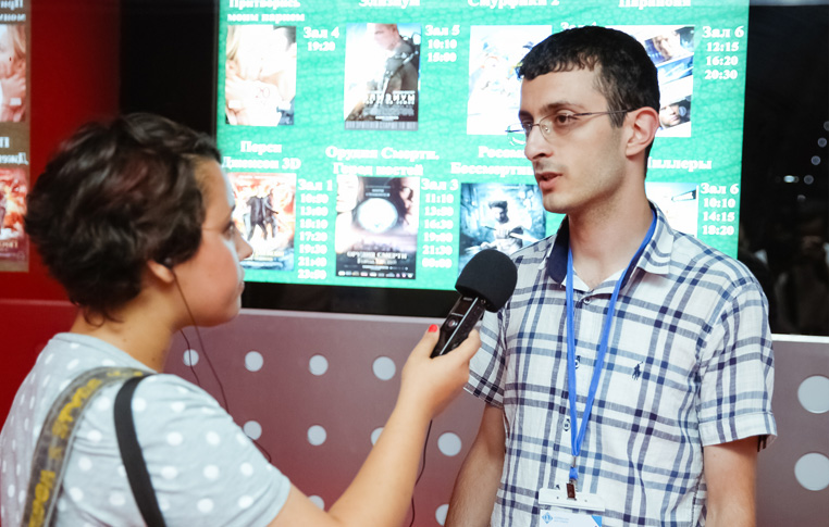 Adil Aliyev giving interview to radio